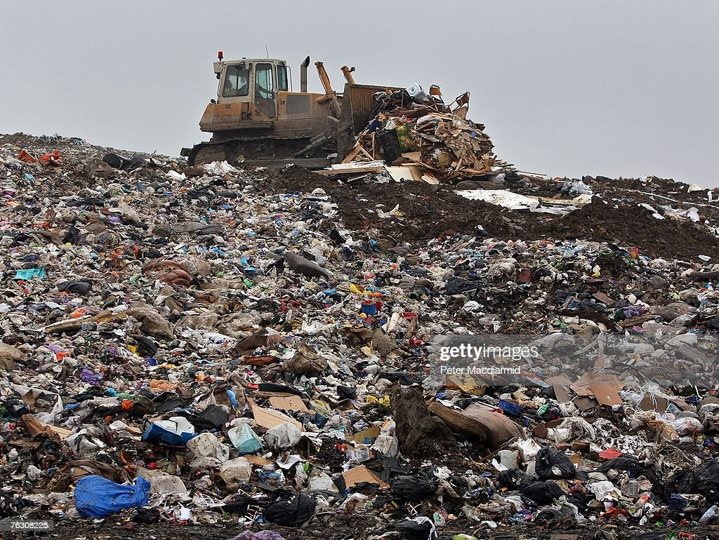 A bull dozer moves rubbish at the Shelford Landfill Recycling Composting Centre on August 23 2007 near Canterbury England The Shelford landfill site...