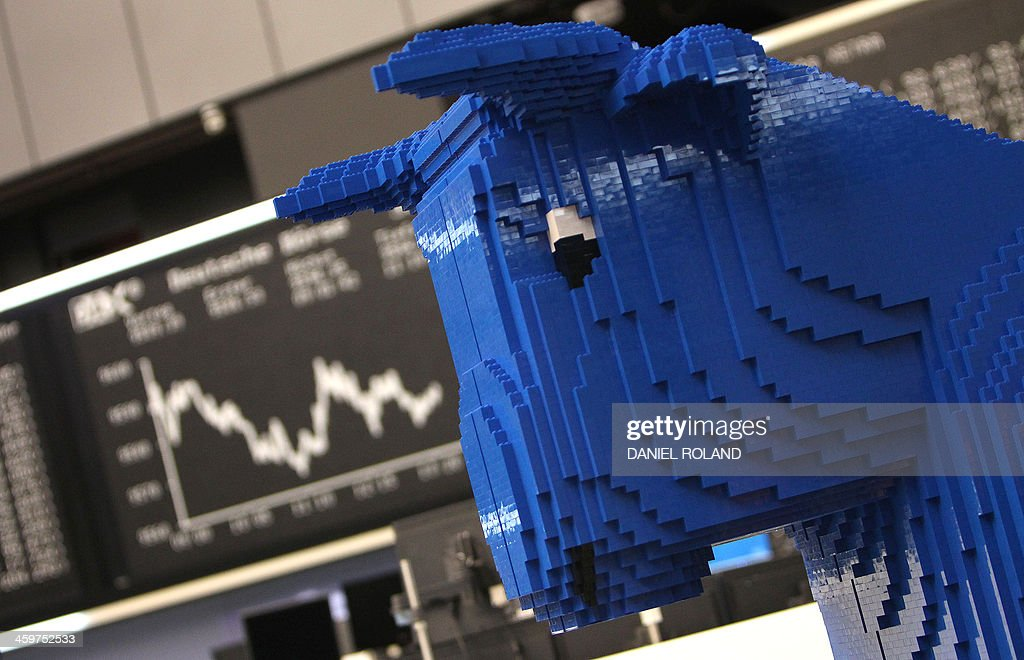 A bull made with Lego blocks is displayed near the Dax index graph board at the last trading day of the year at the stock exchange in Frankfurt, western Germany, on December 30, 2013. ROLAND