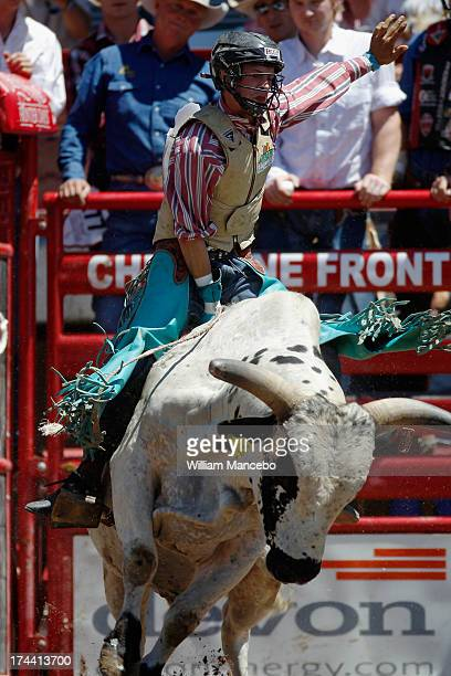 Bull rider Brett Stall is seen during a 79 point ride at the 117th annual Frontier Days rodeo and western celebration on July 22 2013 in Cheyenne...
