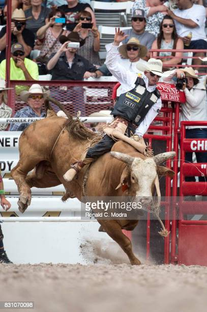 Bull rider Douglas Duncan rides during the Frontier Days Rodeo on July 23 2017 in Cheyenne Wyoming