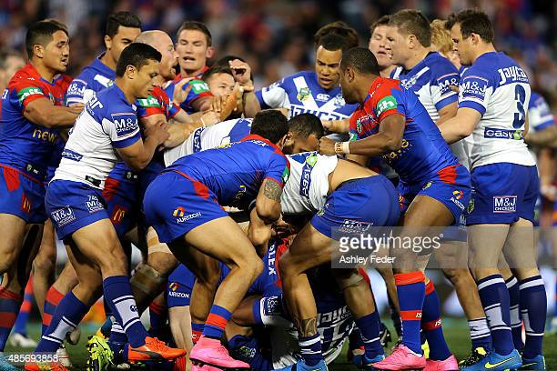 Bulldogs and Knights players during an altercation during the round 25 NRL match between the Newcastle Knights and the Canterbury Bulldogs at Hunter...