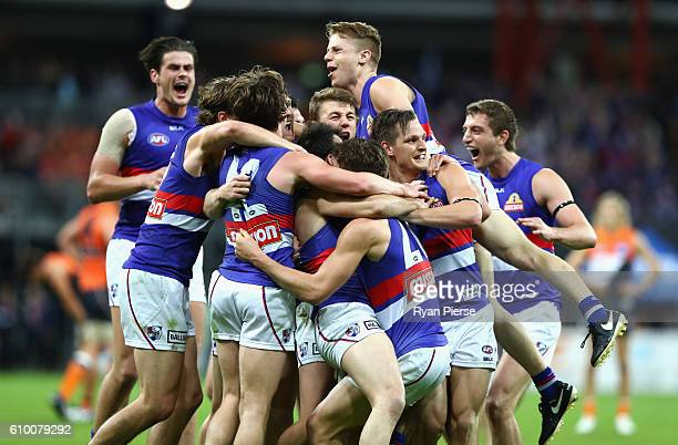 Bulldogs celebrate victory afte the AFL First Preliminary Final match between the Greater Western Sydney Giants and the Western Bulldogs at Spotless...