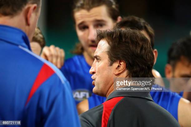 Bulldogs coach Luke Beveridge talks to players during the round 12 AFL match between the Sydney Swans and the Western Bulldogs at Sydney Cricket...