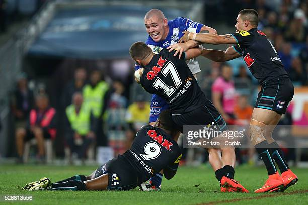 Bulldogs David Klemmer is tackled by Panthers James Segeyaro Lewis Brown and Will Smith during the Preliminary Final at ANZ Stadium Sydney Australia...