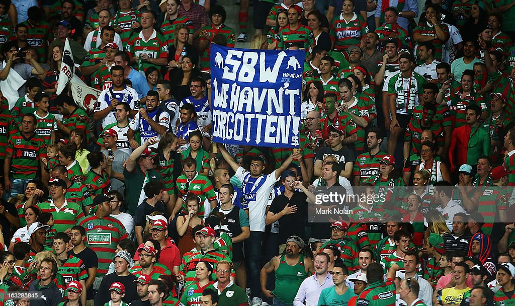 A Bulldogs fan holds a sign relating to Sonny Bill Williams walk out on the Bulldogs five years ago during the round one NRL match between the Sydney Roosters and the South Sydney Rabbitohs at Allianz Stadium on March 7, 2013 in Sydney, Australia.