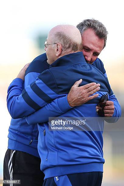 Bulldogs Hall Of Fame Legend Doug Hawkins is hugged by club doctor Jake Lansberger during the Western Bulldogs IntraClub at Whitten Oval on March 13...