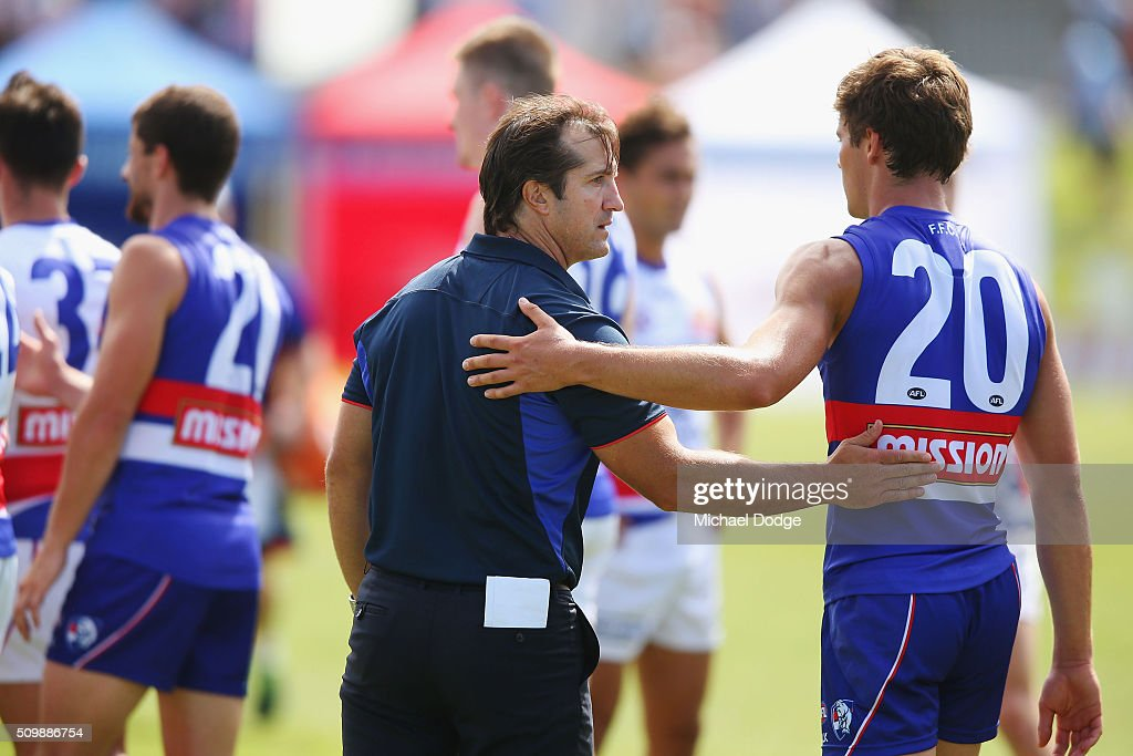 Bulldogs head coach Luke Beveridge geets Josh Dunkley after the Western Bulldogs AFL intra-club match at Whitten Oval on February 13, 2016 in Melbourne, Australia.