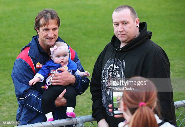 Bulldogs head coach Luke Beveridge poses with a baby for fans during a Western Bulldogs AFL training session at Whitten Oval on May 17 2016 in...