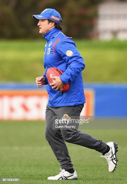 Bulldogs head coach Luke Beveridge runs during a Western Bulldogs AFL training session at Whitten Oval on June 27 2017 in Melbourne Australia
