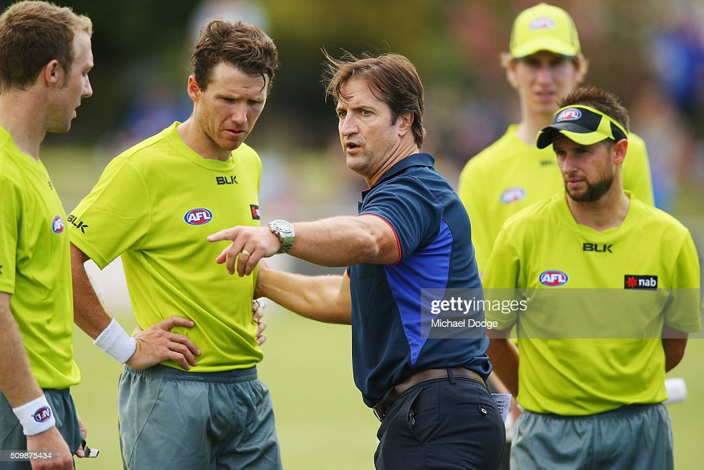 Bulldogs head coach Luke Beveridge talks to the umpires to find out more about an umpiring rule during the Western Bulldogs AFL intra-club match at Whitten Oval on February 13, 2016 in Melbourne, Australia.