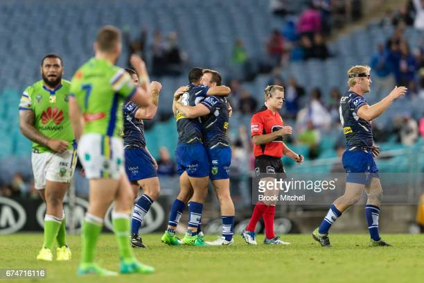 Bulldogs players celebrate after their victory in the round nine NRL match between the Canterbury Bulldogs and the Canberra Raiders at ANZ Stadium on...
