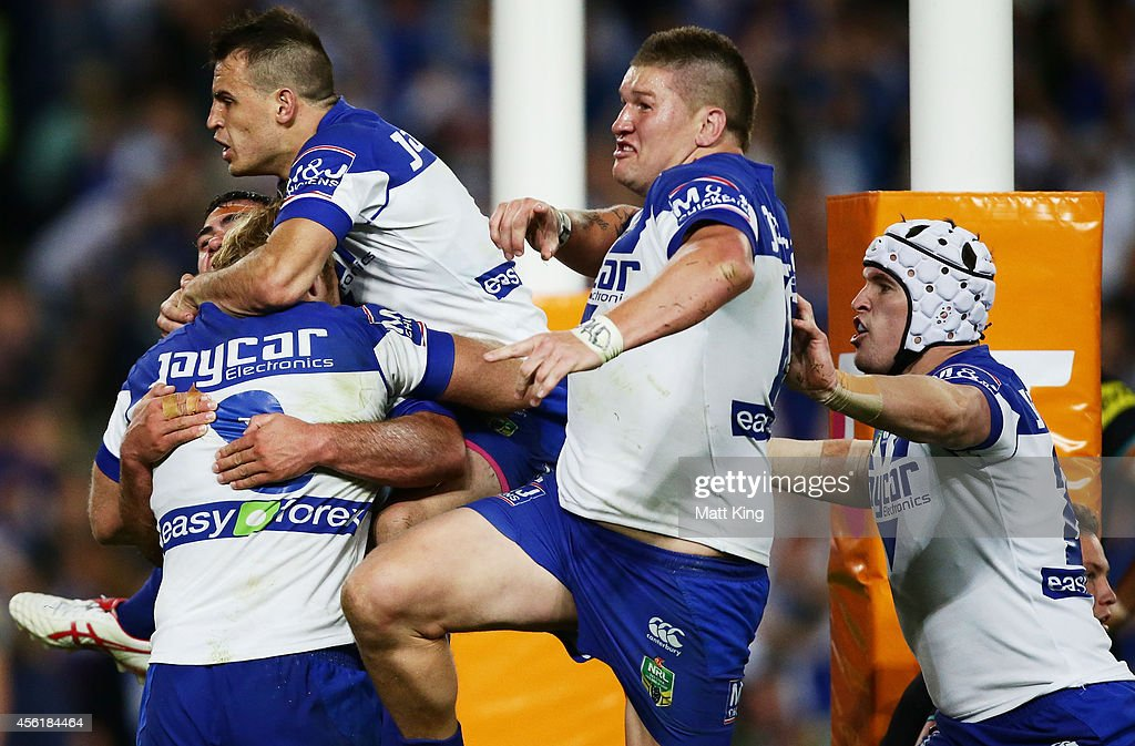 Bulldogs players celebrate the try to Dale Finucane during the NRL Second Preliminary Final match between the Penrith Panthers and the Canterbury...