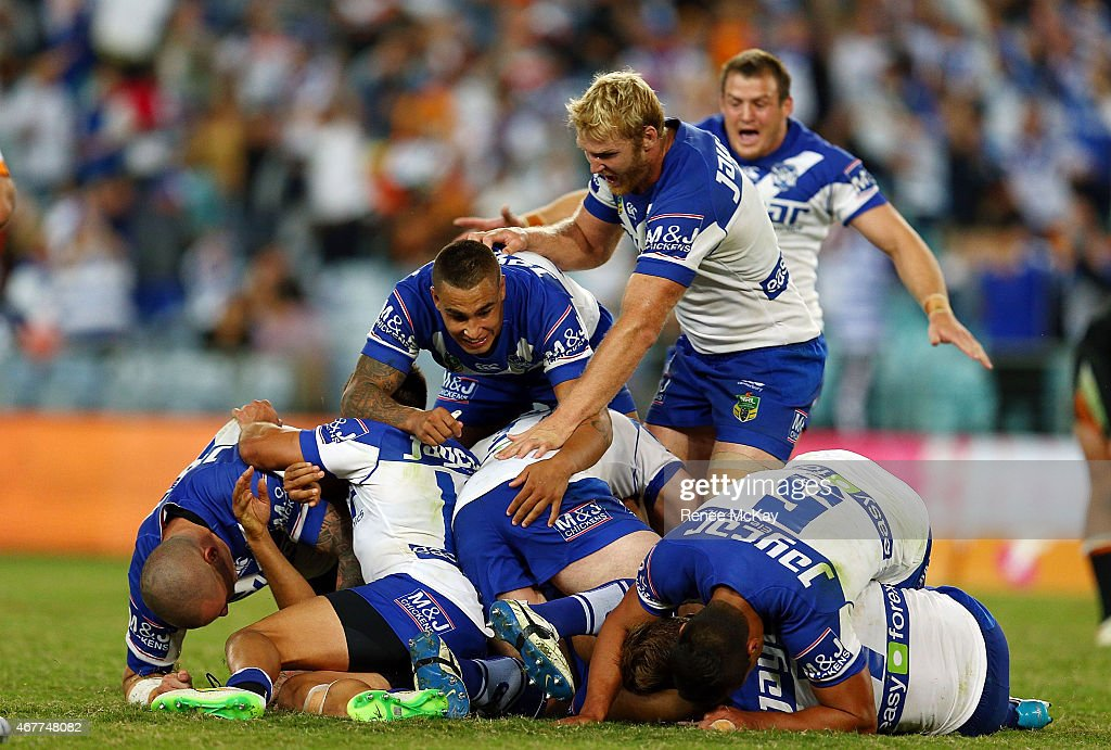Bulldogs players celebrate their win in golden point time during the round four NRL match between the Wests Tigers and the Canterbury Bulldogs at ANZ...