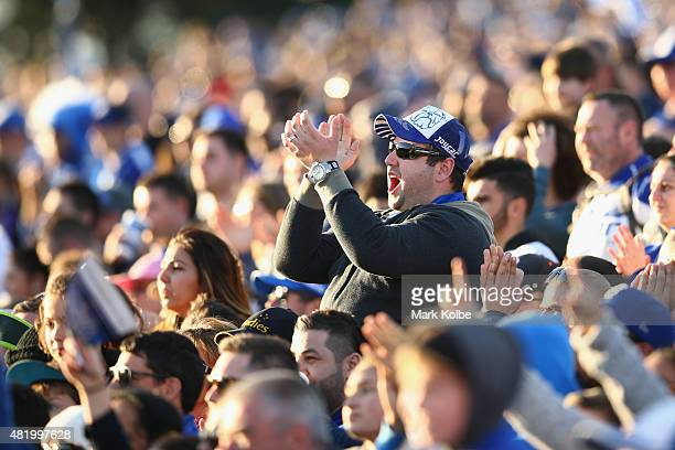Bulldogs supporter in the crowd cheers during the round 20 NRL match between the Canterbury Bulldogs and the Cronulla Sharks at Belmore Sports Ground...