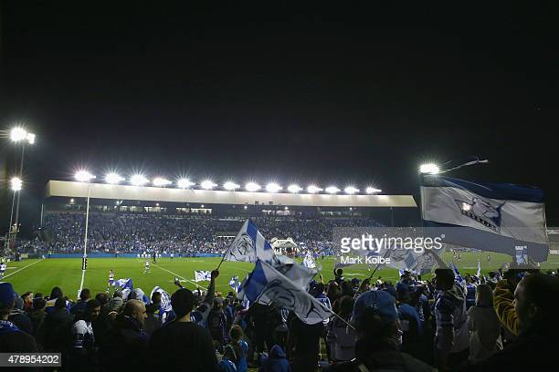Bulldogs supporters cheer as the Buldogs take the field during the round 16 NRL match between the Canterbury Bulldogs and the Melbourne Storm at...
