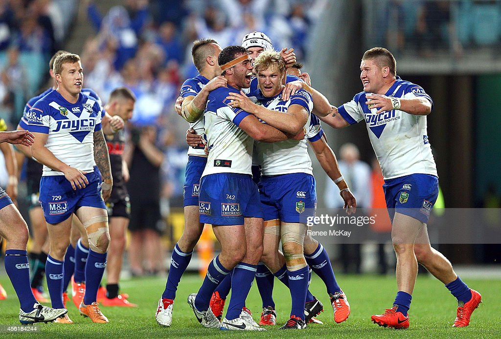 Bulldogs try scorer Dale Finucane celebrates his try with Aiden Tolman and team mates during the NRL Second Preliminary Final match between the...