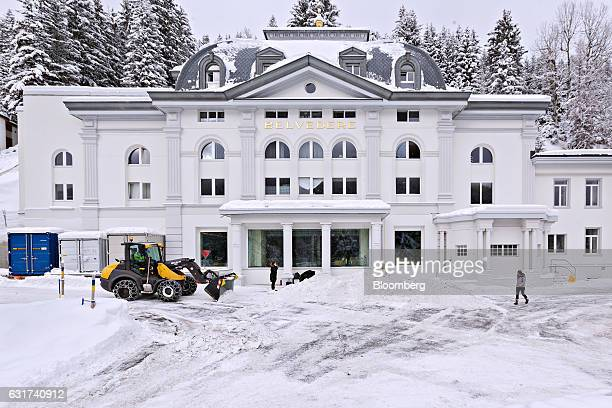A bulldozer clears snow in front of the Belvedere hotel in Davos Switzerland on Sunday Jan 15 2017 World leaders influential executives bankers and...