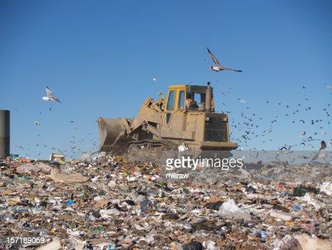 Bulldozer Crushing Trash at Dump