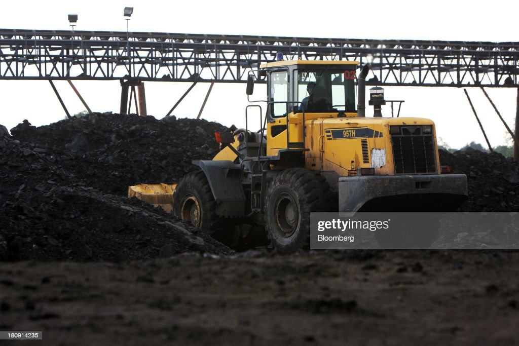 A bulldozer forms a stockpile of coal at a storage area of the PT Exploitasi Energi Indonesia open pit coal mine in Palaran, East Kalimantan province, Indonesia, on Friday, Sept. 13, 2013. Prices of power-station coal in Indonesia, the worlds biggest exporter, may be little changed in coming weeks, according to Bloomberg News survey. Photographer: Dadang Tri/Bloomberg via Getty Images