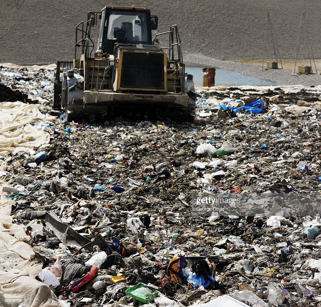 bulldozer in a garbage dump : Stock Photo