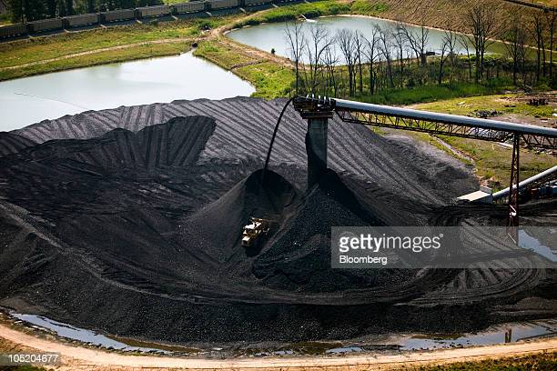 A bulldozer moves coal at Foresight Energy LLC's Pond Creek longwall coal mine in Johnson City Illinois US in this aerial photo taken on Monday June...