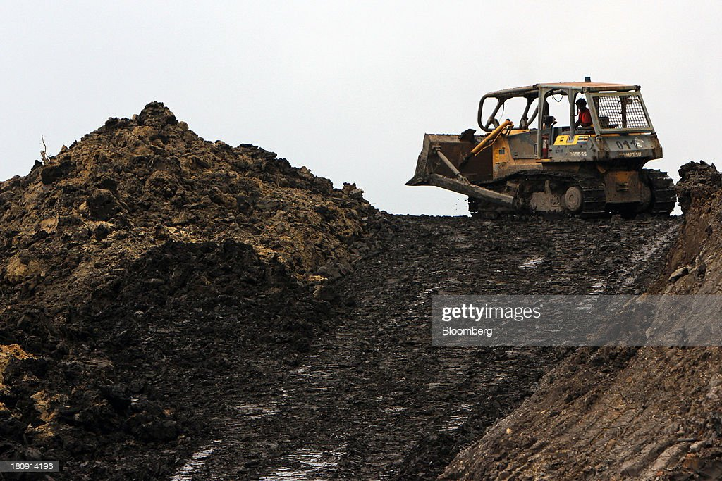 A bulldozer operates at the PT Exploitasi Energi Indonesia open pit coal mine in Palaran, East Kalimantan province, Indonesia, on Friday, Sept. 13, 2013. Prices of power-station coal in Indonesia, the worlds biggest exporter, may be little changed in coming weeks, according to Bloomberg News survey. Photographer: Dadang Tri/Bloomberg via Getty Images