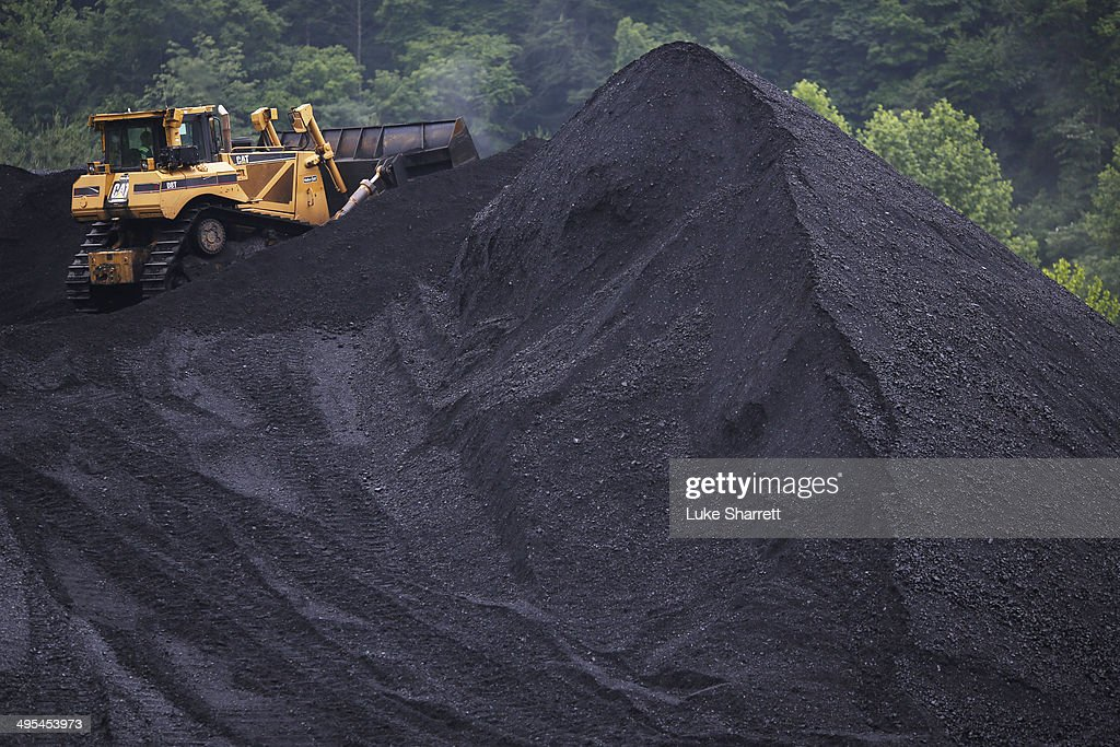A bulldozer operates atop a coal mound at the CCI Energy Slones Branch Terminal June 3 2014 in Shelbiana Kentucky New regulations on carbon emissions...