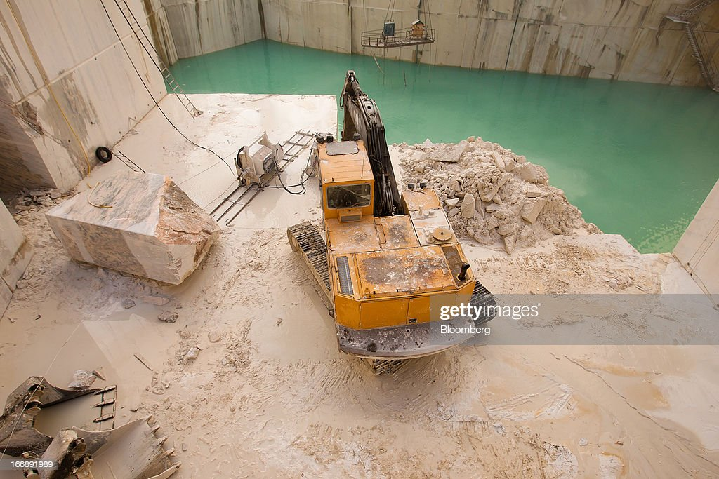 A bulldozer operates in a marble quarry pit operated by Bloco B in Pardais, Vila Vicosa, Portugal, on Wednesday, April 17, 2013. Portugal is posting its first trade surplus in at least six decades, which may help vindicate a strategy of front-loading austerity to deliver economic reform. Photographer: Mario Proenca/Bloomberg via Getty Images
