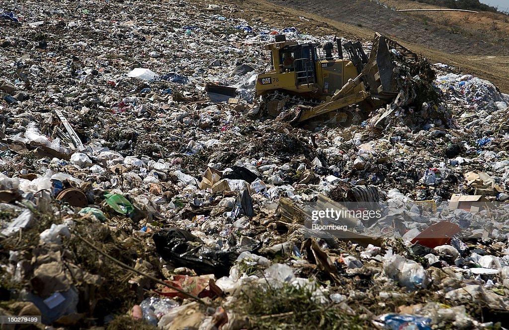 A bulldozer pushes trash into piles at the Miramar Landfill in San Diego California US on Monday Aug 13 2012 Miramar Landfill an environmentally...