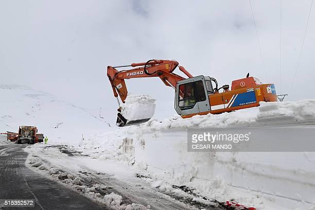 A bulldozer removes snow from a road after heavy snowfall between Las Machorras and the ski resort of Lunada near Espinosa de los Monteros in the...