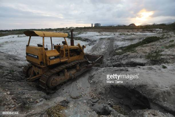 A bulldozer sits outside the edge of the Olympic Golf Course on March 13 2017 in Rio de Janeiro Brazil Seven months after the Rio hosted the first...