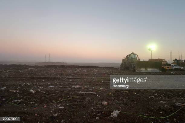 A bulldozer stands in a landfill cell at the Melbourne Regional Landfill site operated by Cleanaway Waste Management Ltd in Ravenhall Victoria...