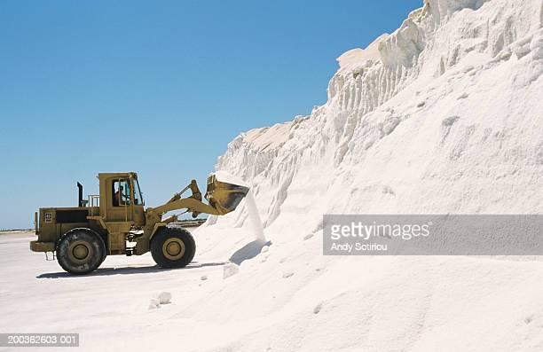 Bulldozer truck loading salt at refining plant, Spain