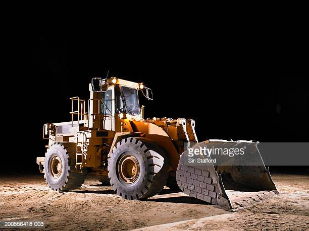 Bulldozer with shovel lowered