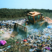 Bulldozer working on landfill site,UK