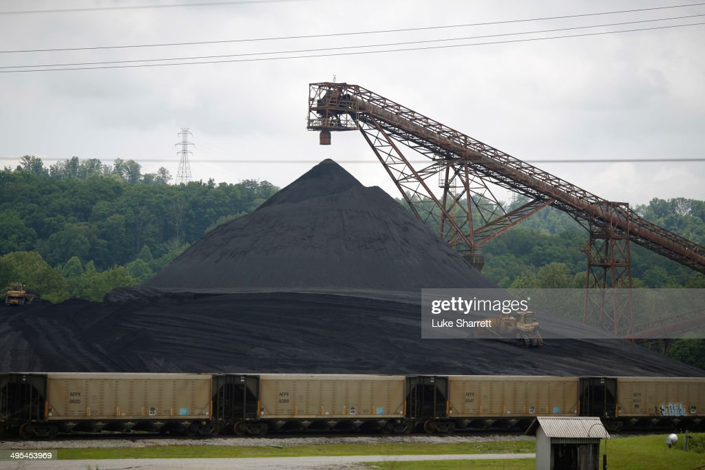 A bulldozer works a coal mound at the Appalachian Electric Power coalfired Big Sandy Power Plant June 3 2014 in Cattletsburg Kentucky New regulations...