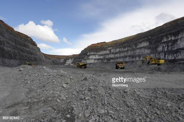 Bulldozers and excavators operate in the Invincible open pit mine at the St Ives Gold Mine operated by Gold Fields Ltd in Kambalda Australia on...