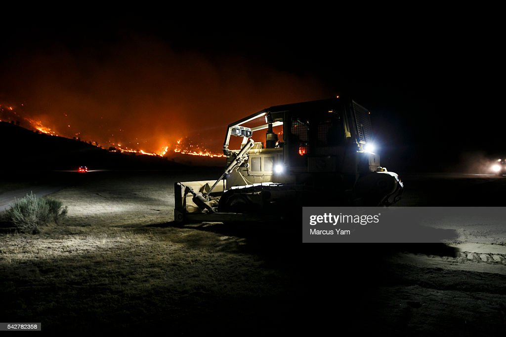 Bulldozers clear a fire break in Kelso Valley, at the head of the wildfire, near Lake Isabella, Calif., on June 24, 2016.