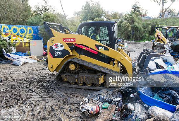 Bulldozers remove debris at a Silicon Valley homeless encampment known as The Jungle on December 4 in San Jose California Authorities began...