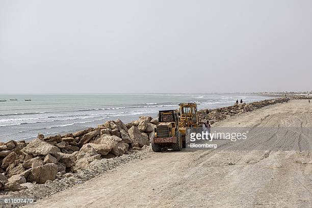 Bulldozers sit parked at a road construction site at Marine Drive in Gwadar Balochistan Pakistan on Wednesday Aug 3 2016 Gwadar is the cornerstone of...