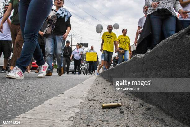 A bullet case is seen on the street as residents of Rio de Janeiro's Jacarezinho and Manguinhos favelas march in demand of peace in Rio Brazil on...