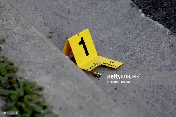 A bullet casing marked by police at the scene A fatal shooting occurred in front of the Wilson Yard Senior Living building at 1032 W Montrose Avenue...