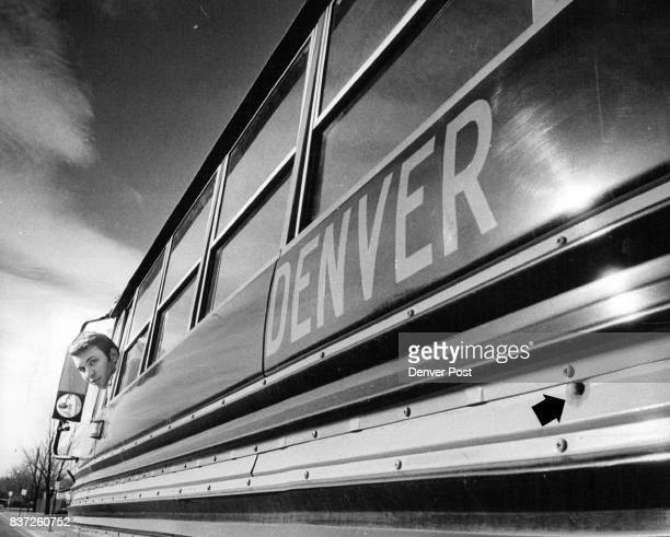 Bullet Fired at Denver School Bus Driver Richard Smith peers from the window at his driver's seat at the bullet hole in a Denver public school bus...
