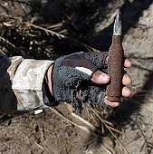 Baghdad, Iraq, March 20, 2005 -  An engineer with Battalion Landing Team 1/1 and native of Rupert, Idaho, displays a bullet found near a weapons cache while on a patrol. The 15th Marine Expeditionary