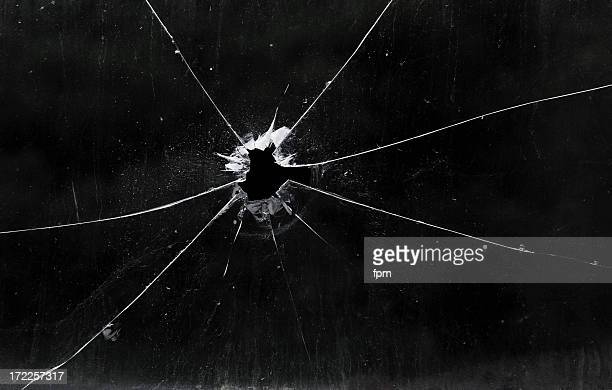 A bullet hole in a glass window
