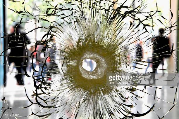 A bullet hole is seen in a window near to the Marks and Spencer on the Champs Elysees in Paris following yesterday's shooting of a police officer on...
