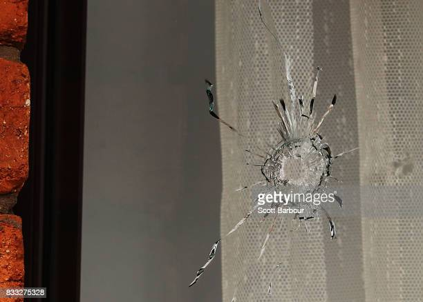 A bullet hole is seen in a window next to the front door after a driveby shooting at a property in Narre Warren in Melbourne's south eastern suburbs...