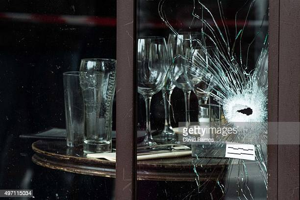 Bullet holes and marks are seen on the windows of the Cafe Bonne Biere restaurant on November 14 2015 in Paris France At least 120 people have been...