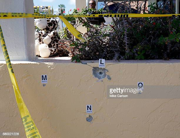 Bullet holes are marked outside of Club Blu where two people were killed and at least 15 wounded on July 25 2016 in Fort Myers Florida Three people...