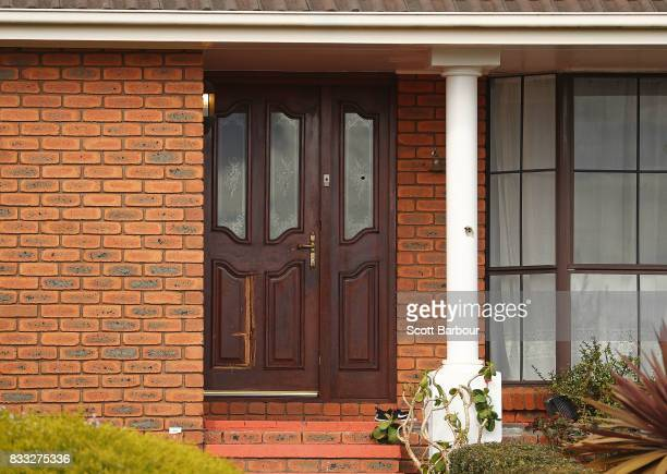 Bullet holes are seen in the front door and windows after a driveby shooting at a property in Narre Warren in Melbourne's south eastern suburbs on...